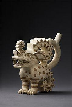 Moche culture North coast 100 – 800 AD Stirrup vessel in the form of a crested feline ceramic   Ministerio de Cultura del Perú: Museo de Sitio de Chan Chan, Dos Cabezas Photograph: Daniel Giannoni