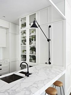 black faucet marble counter