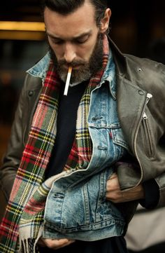 Like these layers a lot: jean jacket under black leather motorcycle jacket with plaid wool scarf.