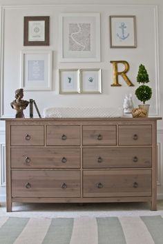 Like the drawer pulls on this Hemnes dresser. We have this dresser in white in our master. Love the artwork layout above dresser. Sarah Knuth via Project Nursery.