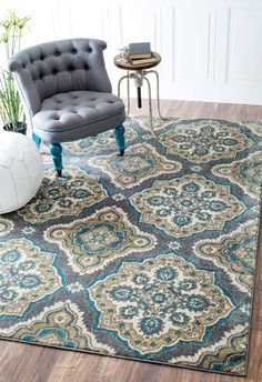 Floral Trellis Rug: The polypropylene and polyester construction of this floral trellis rug allows you to use it in high traffic areas easily. This machine made rug has an elegant look and comes in two sizes to suit your area.