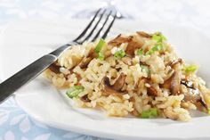 """A bowl of silky-creamy risotto. Typically served as a """"primo,"""" or first course, risotto preparation is an art: al dente, but cooked enough that the starch from the rice creates a smooth and creamy consistency Mushroom Risotto, Side Dish Recipes, Rice Recipes, Side Dishes, Vegan Cookbook, One Pot Meals, Italian Recipes, Stuffed Mushrooms, Risotto"""
