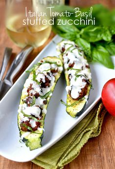 Italian Tomato-Basil Stuffed Zucchini is a light, low-carb, gluten-free summer dinner. Easy and so satisfying!   iowagirleats.com