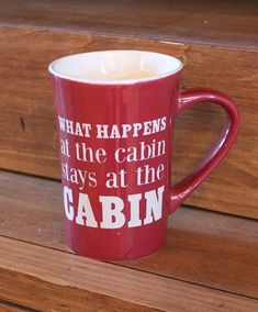 """A reminder that """"what happens at the cabin stays at the cabin!""""This latte mug measures 5"""" tall by 5"""" wide."""