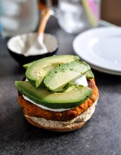 Smoky sweet potato burgers with roasted garlic cream and avocado.