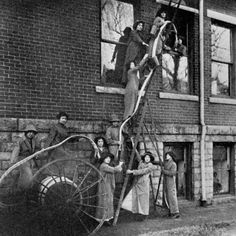 Students learning how to fight fires at an Agnes Scott College dormitory. c. 1913