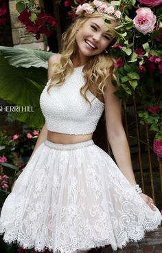 This beautiful Sherri Hill 32313 is so elegant. This two piece short dress embellished with pearls is a homecoming gal's dream! The halter neckline top is covered in dainty pearls and the lacy skirt features a scalloped hemline lets off a sweet vibe that no one can resist.