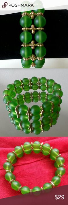 BRACELET,  FINAL PRICE JADE GREEN THIS BEAUTIFUL TRANSLUSCENT JADE GREEN AND GOLD TONED BRACELET IS MAGNIFICENT.   IT IS DESIGNED WITH DOUBLE STRANDS OF  TRANSLUCENT JADE GREEN BEADS AND GORGEOUS TRIPLE GOLD FLOWERY INSERTS BETWEEN EACH TEIR OF THE BEADS. THE BRACELET IS STRETCH SO ONE SIZE FITS ALL AND NO WORRIES ABOUT A CLASP. WHEN I WAS DRESSING FOR THE BUSINESS WORLD ON A DAILY BASIS THIS TYPE OF JEWELRY WAS IDEAL.  IT WILL MAKE YOUR OUTFIT AND AS ALWAYS DRAW COMPLIMENTS. Looks brand…