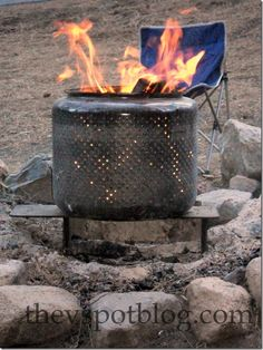 OK, this is not a beautiful transformation, but it sure works great.  Take the drum out of an old machine and use it as a fire-pit.  WELL I LOVE IT AS IS, WANT IT TO BE PRETTY? BUY/USE SOME RUSTOLEUM  SPRAY PAINT FOR WOOD BURNING STOVES ..I BELIEVE THEY STILL SELL IT..OR THEY HAVE MADE SOMETHING LIKE IT HEAT RESISTANT