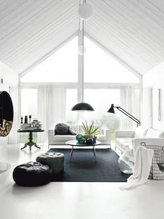 Must-have: Moroccan Pouf (25 pics). Messagenote.com The contrast of white and black in this living room creates a modern masculine space.