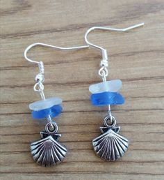 Real seaglass from the beaches in the carribean. Hard to find the real stuff in blue.     https://www.etsy.com/listing/246278816/white-and-blue-sea-glass-clam-earrings