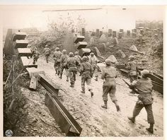 90th Div. Reach The Siegfried Line Infantrymen of the 90th Division pass concrete dragon's teeth of the Siegfried Line in Habscheid Germany as they move up to the front.