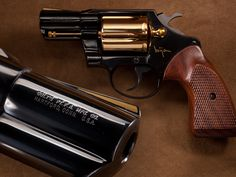 Colt Bijan Revolver – In the mid-1980s, Bijan Pakzad decided to offer a designer line of handguns along with his other wares, having pieces like this double-action Colt customized with gold plating & other special accents. Originally intended to come with a mink carrying pouch & a cut crystal display case & that some were to feature colorful gemstones for front sights, but our Detective Special with its tasteful golden accents is closer to stock, at least as much as any designer edition can…