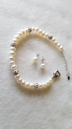 Natural Freshwater Pearl Bracelet. AAA pearl grade and 7mm pearl size. The bracelet comes with matching freshwater earrings and is 7 1/2 inches long.