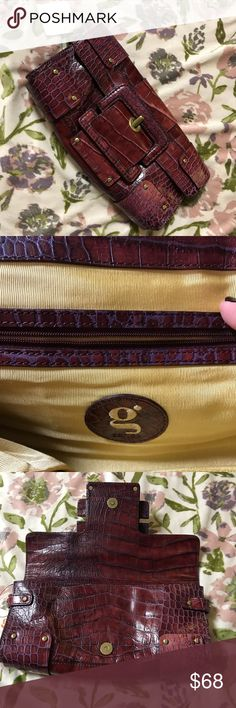 G by Guess alligator burgundy clutch!!👑👛👜✨💫 Brand new G by GUESS Marciano  WITH TAGS!!, deep maroon/burgundy, oversized alligator embellished clutch, Absolutely adorable! Has original tag on it, and has such a chick day/night wear. Make me an offer!! Would love for it to go to the perfect home!!🍁🍂🍄🥀🌹 G by Guess Bags Clutches & Wristlets
