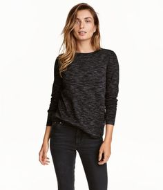 Black melange. CONSCIOUS. Top in melange jersey made from an organic cotton blend. Long sleeves and ribbing at cuffs and hem.