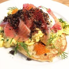 Scrambled eggs over homemade blinis with smoked salmon, roe, crème fraîche and blood sausage crumble at Hardware Société, Paris 18e