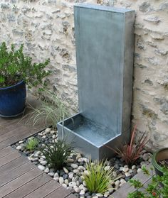 Fontaine de jardin / en zinc FONTAINE ZINC MURALE A DEBORDEMENT OSMOSE SARL