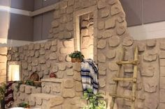 "Nonna's Craft Corner: VBS 2011 ""We worked with 4 foot by 8 foot sheets of foam insulation and carved about a gazillion stones to build our set"""