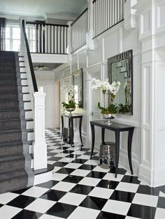 White entry with black and white checkered floors by Susan Glick, via @sarahsarna.