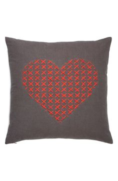 """'Cross My Heart' Pillow $48 Details & Care: A cross-stitched heart lends a burst of rich scarlet color to a charming accent pillow cut from smoky charcoal fabric. 18"""" square. 100% polyester. By Nordstrom at Home; imported."""