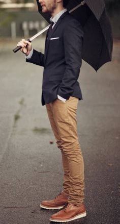 Navy jacket, light brown pants