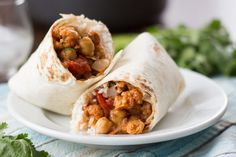 Spicy, saucy curried cauliflower and chickpeas are teamed up with rich coconut infused basmati rice in these flavorful Indian-inspired burritos.