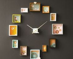 Cute homemade clock with shadow boxes lined with fabric, paper or wallpaper. You can find the clock workings at any craft store. You can make a clock out of pictures or a mural, sky's the limit!