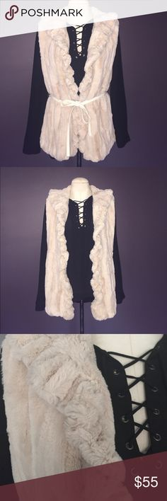 Damselle NY Beige Faux Fur Vest Excellent condition super soft Faux fur vest. The color is a creamy beige. Style it with any long sleeve, sweater, or dress. Polyester lined. Has a curly fold over collar and trim. Can be worn with the provided Faux leather white belt or without if you prefer. Damselle Jackets & Coats Vests
