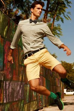 bow tie, yellow shorts, green socks. and he totally pulls it off! :)