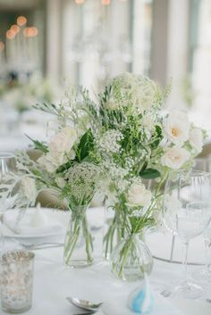 White flower centrepieces with queen annes lace, babys breath and poppys in clear glass bottles | Ria Mishaal Photography | Bridal Musings Wedding Blog 50