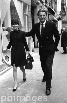 Audrey Hepburn photographed with her beloved Hubert de Givenchy by Spartaco Bodini outside the Givenchy Boutique Paris in Paris.