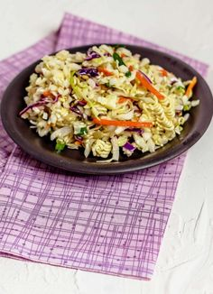 Looking for a budget-friendly salad recipe? Chinese Coleslaw is also known asramen noodle cole slaw. This cheap and easyramen noodle salad recipe is very addicting. One bite of theAsian ramen noodle salad you will want to make for your family picnics all the time! | SeductionInTheKitchen.com #ramen #asian #salad #coleslaw