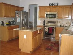 Paint colors to go with oak cabinets.  Shows lots of pictures with different colors.  Photobucket
