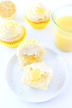 Lemon Curd Cupcakes filled with lemon curd and topped with buttercream frosting. These are the BEST cupcakes!