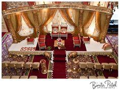 Indian wedding mandap, open mandap with gold pillars and red accents  #indianwedding, #shaadibazaar