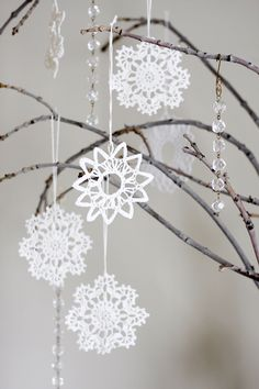 I love this- the real tree branches- the ornaments- everything