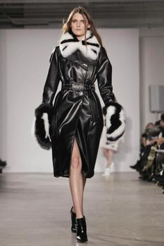 Altuzarra #FW2013#NYFW  Leather black coat, double breasted with black and oversized fur collar and gloves.