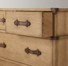 Love this dresser - with metal corner brackets and leather drawer-pulls.  Wilkes Trunk Dresser