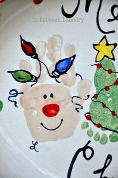 reindeer hands and Christmas tree feet on a Christmas plate ~ we used to make painted plates all the time as a kid...there is some kind of paint that you can use for this that is safe for washing etc...and eating on LOL