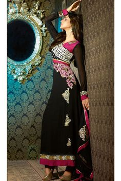 Look striking and stunning with this wonderful straight cut designer salwar kameez. This impressive black color semi-stitched salwar kameez is made from georget