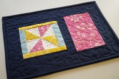 Colorful Floral Mini Quilt, Spring Quilted Patchwork Place Mat in Pink, Blue and Yellow by MyBitOfWonder on Etsy https://www.etsy.com/listing/513741209/colorful-floral-mini-quilt-spring