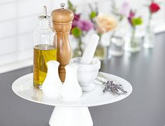 SWEET idea! COOKING KIT  Cluster pantry staples like salt, pepper and olive oil on a cake stand so they're easy to grab as you cook. Bonus: It catches potential drips, leaks and spills for simpler clean up. Get more kitchen efficiency tips>>