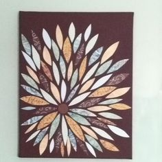Painted a blank canvas then used scrapbook paper to make all the leaves!