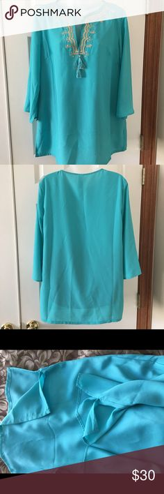 Beautiful teal blue tunic. Awesome tunic in like new condition. Gold sequenced and thread details. Sleeves and bodice have slits at the sides. Non- smoking home. Tops Tunics