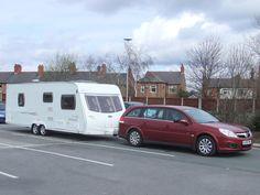 2006 Vauxhall Vectra 1.9 DTi Estate with a Lunar Solaris 22Ft caravan.