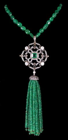 Emerald Bead Tassel Necklace accompanied by 151.20 carats of Emeralds and 2.71 carats of Diamonds. Set in Silver & Gold.