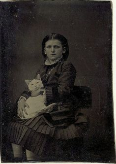 ca. 1870-80's, [tintype portrait of a girl with her cat]  via Ebay
