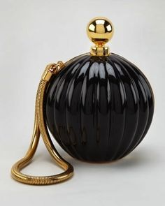 A retro perfume bottle. | 22 Objects You Won't Believe Are Actually Expensive Handbags