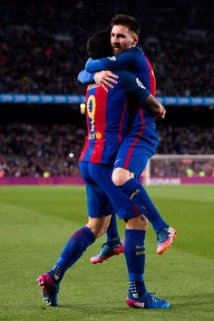Lionel Messi (R) of FC Barcelona celebrates with his teammate Luis Suarez (L) after scoring his team's third goal during the La Liga match between FC Barcelona and Valencia CF at Camp Nou stadium on March 19, 2017 in Barcelona, Catalonia.